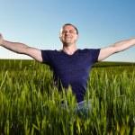 Farmer in a wheat field — Stock Photo