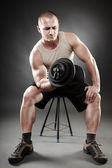 Strong man working out — Stock Photo