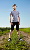 Teen on a countryside road — Stock Photo