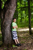 Teenager in the forest — Stock Photo