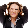 Angry businesswoman on white background — Stock Photo