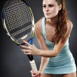 Stock Photo: Female tennis player ready to hit