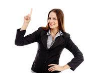 Attraente donna d'affari puntando qualcosa — Foto Stock
