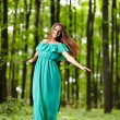 Beautiful woman posing in a forest — Stock Photo