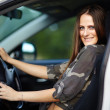 Sexy girl sitting in the car — Stock Photo