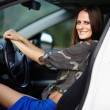 Sexy girl sitting in the car — Foto Stock