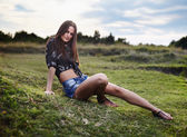 Sexy woman laying on the grass — Stock Photo