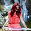 Sexy redhead standing in water — Stock Photo