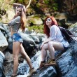 Stock Photo: Attractive women standing on rocks