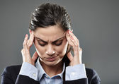 Businesswoman with strong migraine — Stock Photo