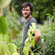 Young farmer in garden — Stock Photo