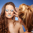 Makeup artist adjusting the makeup — Stock Photo