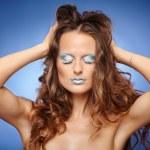 Beautiful woman with fantasy makeup — Stock Photo