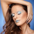 Stock Photo: Beautiful woman with fantasy makeup
