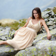 Elegant woman laying on the rocks — Stock Photo