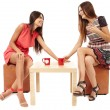 Girlfriends talking over a cup of tea — Stock Photo