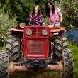 Female farmers driving the tractor — Stock Photo