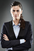 Businesswoman with arms folded — Stock Photo
