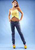 Attractive female in jeans and top — Stock Photo