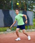 Child playing tennis — Stock Photo