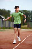 Child playing tennis — Stock Photo