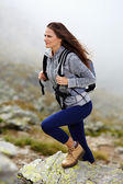 Woman hiker climbing — Stock Photo