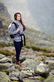Woman hiker smiling — Stock Photo