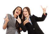 Businesswomen making the rock and roll hand gesture — Stock Photo