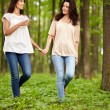 Mother and daughter walking hand in hand — Stockfoto