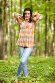 Woman in a forest — Stock Photo