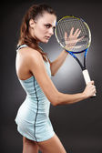 Female tennis player preparing to execute a backhand volley — Stock Photo