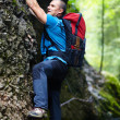 Man climbing mountain wall — Stock Photo