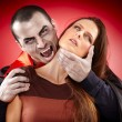 Vampire preparing to bite his victim — Stock Photo