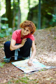 Female tourist looking on a map — Stock Photo