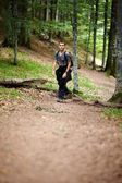 Boy hiking in a mountain forest — Stock Photo