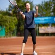 Tennis player executing a forehand volley — Foto Stock