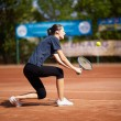 Tennis player executing a backhand volley — Stock Photo