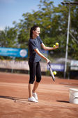 Tennis instructor teaching — Stock Photo