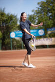 Tennis player executing a forehand volley — Stock Photo