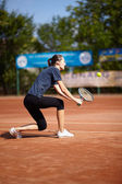 Tennis player executing a backhand volley — Zdjęcie stockowe