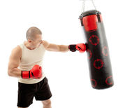 Boxer hitting the punching bag — Stock Photo