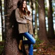 Stock Photo: Womleaning on tree