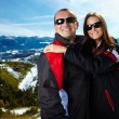 Happy couple in the mountains — Stock Photo