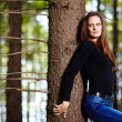 Woman leaning on a tree — Foto Stock