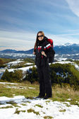 Woman hiker in the mountains — Stock Photo