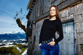 Beautiful woman near cabin log — Stock Photo