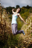 Young woman jumping of joy — Stock Photo