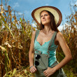 Attractive woman farmer in the cornfield — Stock Photo #34772019