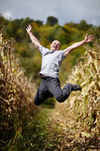 Young man jumping of joy — Stock Photo