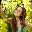Beautiful woman enjoying a sunny day in the park — Stock Photo